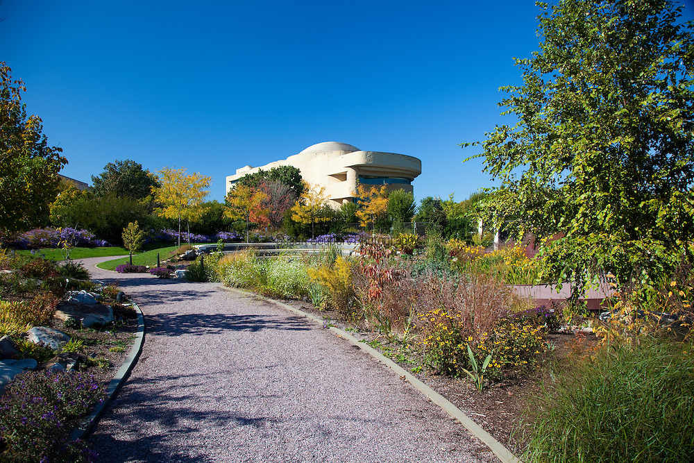 """The U.S. Botanic Garden's National Garden opened to the public on October 1, 2006. It provides """"living laboratories"""" for environmental, horticultural, and botanical education in a contemplative setting.  In the background, the National Museum of the American Indian, which first opened to the public in 2004."""