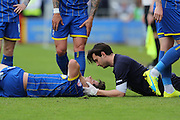 Connor Smith defender for AFC Wimbledon (18) receives treatment during Sky Bet League 2 match between AFC Wimbledon and Newport County at the Cherry Red Records Stadium, Kingston, England on 7 May 2016. Photo by Stuart Butcher.