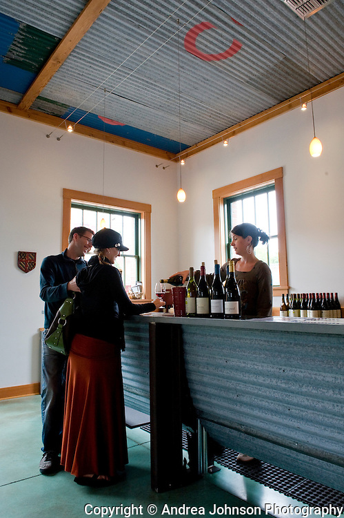 Couple enjoy wine tasting pinot noir at Scott Paul Wines tasting room, Carlton, Willamette Valley, Oregon