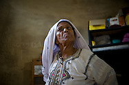 Sherbano has been a dai for over 40 years. She doesn't know her age but recounts many of the deliveries she's handled over the years. <br /> Trained by her mother and grandmother, she conducts both normal and breach deliveries. Most dai deny delivering any complicated cases and say they refer the patients to nearby hospitals. Yet most maternal deaths happen due to untimely referral or the lack of skill by the dai. Rehri Goth, Karachi, Pakistan, 2011