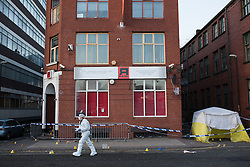 © Licensed to London News Pictures . FILE PICTURE DATED 4th JANUARY 2015 OF THE MURDER SCENE as two men have today (4th December 2015) been sentenced to seven and three years respectively following the death of Clarence Edwards , outside the R Base nightclub in Manchester , on 4th January 2015 . Earl Atta Rooms (b 16/03/88) of Roberts Avenue Rusholme was handed a seven year sentence for manslaughter with three years to run concurrently for violent disorder , and Dwayne Henry (b 25/01/81) of Carlton Avenue , Rusholme , was senteced to three years for violent disorder . Photo credit : Joel Goodman/LNP