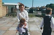 Two brothers, older one with his hands on the younger brothers shoulders, Winterbourne Travellers site, Bristol, UK, 1990's