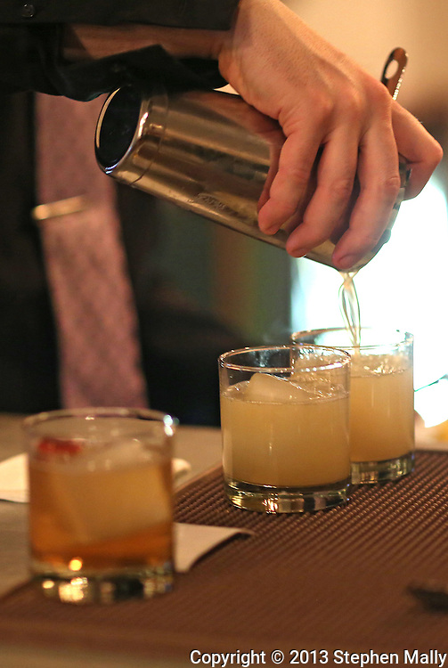 A drink is prepared at the bar at Cobble Hill in Cedar Rapids on Friday, February 8, 2013.