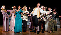 """Prince Dauntless played by Mitchell Bailey is surrounded by his ladies in waiting at the final dress rehearsal for Laconia High School's production of """"Once Upon A Mattress"""" Wednesday evening.  (Karen Bobotas/for the Laconia Daily Sun)"""