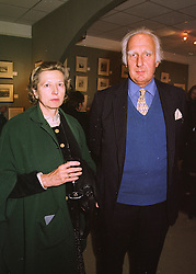 MR DAVID & the HON.MRS BUCHAN, she is the daughter of Lord Howard de Walden, at an exhibition in London on 22nd April 1998.MGW 6