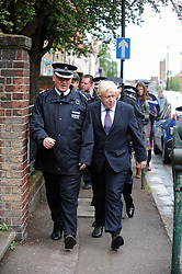 © Licensed to London News Pictures. 23/05/2013.Woolwich Soldier Murder.Boris Johnson   Mayor of London arriving at Market Street, Woolwich to walk the murder scene..Woolwich 'terrorist attack': One dead and two seriously injured. Woolwich Barracks,Woolwich..Photo credit :Grant Falvey/LNP