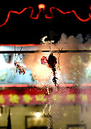 Firecrackers explode at the Thien Hau temple to celebrate the first day of the Chinese Lunar New Year, the Year of the Dog, on Thursday February 16, 2018, in Los Angeles.. (Xinhua/Zhao Hanrong)<br /> 2月16日,农历正月初一凌晨,在美国洛杉矶,大批华人涌入中国城天后宫庙上香祈福。图为民众在庙前烧炮。新华社发 (赵汉荣摄) (Photo by Ringo Chiu)<br /> <br /> Usage Notes: This content is intended for editorial use only. For other uses, additional clearances may be required.