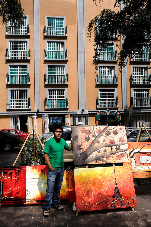 An artist sells his work at a weekend art market in Colonia Roma Norte in Mexico City.