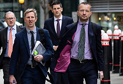 © Licensed to London News Pictures. 17/04/2018. London, UK. JONATHAN MUNRO (R), Head of BBC Newsgathering, arrives at the Rolls Building of the High Court in London where Sir Cliff Richard is claiming damages against the BBC for loss of earnings. The 77-year-old singer is suing the corporation after his home in Sunningdale, Berkshire was raided following allegations of sexual assault made to Metropolitan Police. Photo credit: Rob Pinney/LNP