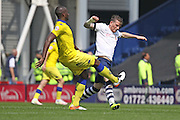 Leeds United defender, Souleman Bamba (3) challenges Joe Garner during the Sky Bet Championship match between Preston North End and Leeds United at Deepdale, Preston, England on 7 May 2016. Photo by Pete Burns.