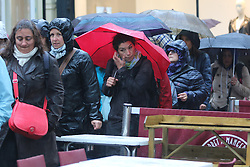 © Licensed to London News Pictures. 14/05/2015. Brighton, UK. Members of the public take shelter from the rain under their umbrella. Heavy rain has been forecasted for most of the day down the South Coast, today Thursday May 14th 2015. Photo credit : Hugo Michiels/LNP