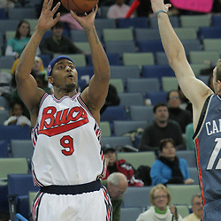 10 December 2008: New Orleans Hornets guard Morris Peterson (9) shoots over Charlotte Bobcats guard Matt Carroll (13) during a 105-89 win by the New Orleans Hornets over the Charlotte Bobcats on a Hardwood Classics Night as the Hornets honored the 40th Anniversary the 1967-68 New Orleans Bucs ABA franchise at the New Orleans Arena in New Orleans, LA. .