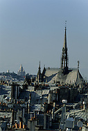 France. Paris. elevated view on the Sacre Coeur.  The Sainte Chapelle church, The sacre coeur and Paris roofs. view from Parc Saint- Severin hotel
