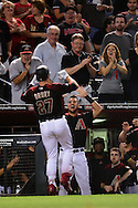 PHOENIX, AZ - APRIL 30:  Brandon Drury #27 of the Arizona Diamondbacks is congratulate by teammate David Peralta #6 after hitting a two run home run against the Colorado Rockies during the sixth inning at Chase Field on April 30, 2016 in Phoenix, Arizona.  (Photo by Jennifer Stewart/Getty Images)