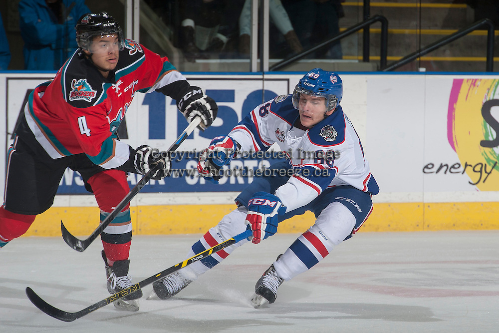 KELOWNA, CANADA - NOVEMBER 29: Pavel Padakin #68 of Regina Pats tries to block the pass from Madison Bowey #4 of Kelowna Rockets on November 29, 2014 at Prospera Place in Kelowna, British Columbia, Canada.  (Photo by Marissa Baecker/Shoot the Breeze)  *** Local Caption *** Pavel Padakin; Madison Bowey;