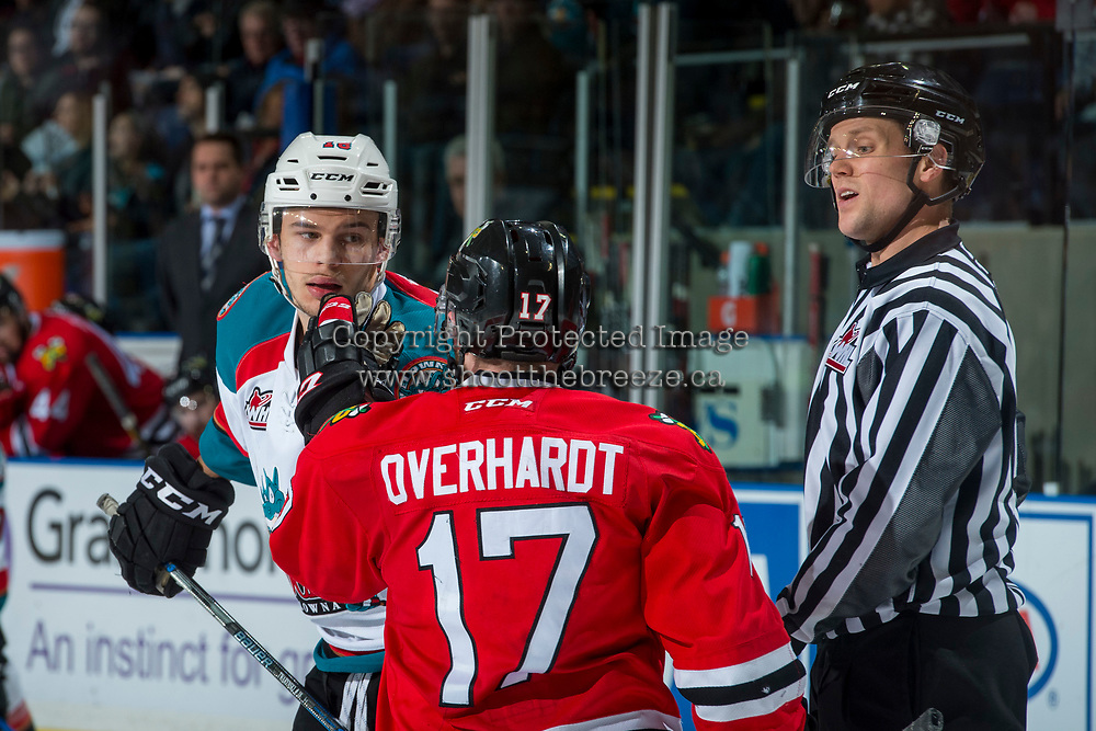 KELOWNA, CANADA - APRIL 8: Alex Overhardt #17 of the Portland Winterhawks gets in the face of Carsen Twarynski #18 of the Kelowna Rockets as linesman Dustin Minty calls him out on April 8, 2017 at Prospera Place in Kelowna, British Columbia, Canada.  (Photo by Marissa Baecker/Shoot the Breeze)  *** Local Caption ***