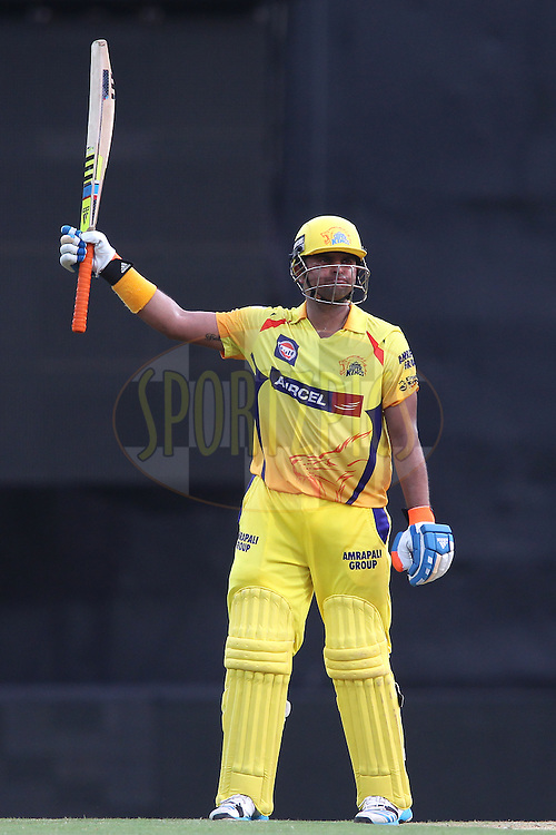 Suresh Raina of Chennai Super Kings raises his bat after reaching his fifty during match 37 of the Pepsi IPL 2015 (Indian Premier League) between The Chennai Superkings and The Royal Challengers Bangalore held at the M. A. Chidambaram Stadium, Chennai Stadium in Chennai, India on the 4th May April 2015.<br /> <br /> Photo by:  Shaun Roy / SPORTZPICS / IPL