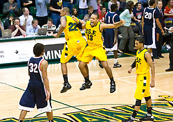 January 30, 2010; Berkeley, CA, USA;  San Francisco Dons forward Perris Blackwell (22) and guard Rashad Green (13) celebrate in overtime against the Gonzaga Bulldogs at the War Memorial Gym.  San Francisco defeated Gonzaga 81-77 in overtime.
