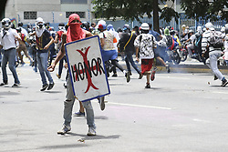 June 5, 2017 - Caracas, Venezuela - Caracas, on June 5, 2017. Prominent opposition leader jailed in Venezuela, Leopoldo Lopez, urged more street protests against the ''tyranny'' of President Nicolas Maduro, in a video message made in his cell and released on Sunday. Lopez, 46, however stressed several times that he backed only ''peaceful'' demonstrations...Manifestant (Credit Image: © Panoramic via ZUMA Press)