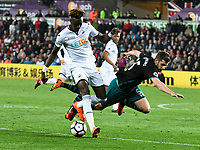 Football - 2017 / 2018 Premier League - Swansea City vs. Southampton<br /> <br /> Tammy Abraham of Swansea City attacks & Jack Stephens of Southampton falls, at Liberty Stadium.<br /> <br /> COLORSPORT/WINSTON BYNORTH
