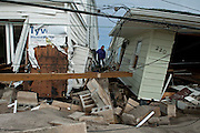 Houses on the ocean side of Breezy Point were lifted clear off their foundations, often floating into the middle of the street. Jonah Markowitz/Falcon Photo Agency