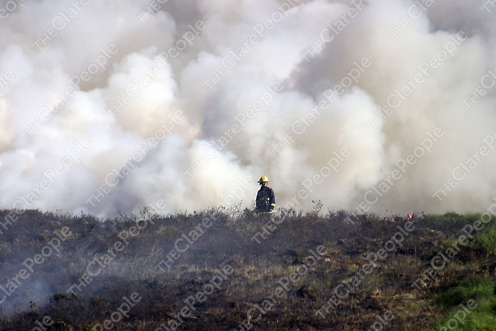 Firefighters emerge from the thick smoke to take a short break before returning to tackle a hugh fire which broke out across land outside Miltown Malbay yesterday evening.<br /><br /><br /><br />Photograph by Yvonne Vaughan.