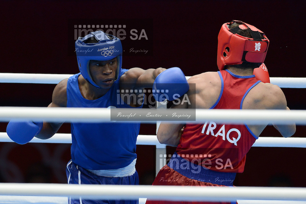 LONDON, ENGLAND - JULY 29, Siphiwe Lusizi of South Africa (blue) versus Abdulkareem Ahmed Ahmed of Iraq (red) during the Mens Round of 32 Bantam 69kg boxing match at Excel, South Arena 2 on July 29, 2012 in London, England.Photo by Roger Sedres / Gallo Images