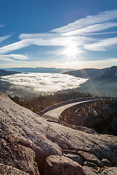 """Donner Lake Morning 8"" - Photograph of a fogged over Donner Lake and Truckee, California with Rainbow Bridge in the foreground."