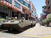 21 MAY 2010 - BANGKOK, THAILAND: Thai armored cars parked in the Patpong night club district of Bangkok. Clean up continued in Bangkok Friday, two days after the army cleared the streets of anti government protesters.  PHOTO BY JACK KURTZ