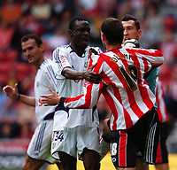 Fotball<br /> England 2005/2006<br /> Foto: SBI/Digitalsport<br /> NORWAY ONLY<br /> <br /> Southampton v Anderlecht<br /> Pre Season Friendly, 30/07/2005. <br /> <br /> Anderlechts Lamine Traore clashes with Rory Delap after Delap went in late on the keeper.
