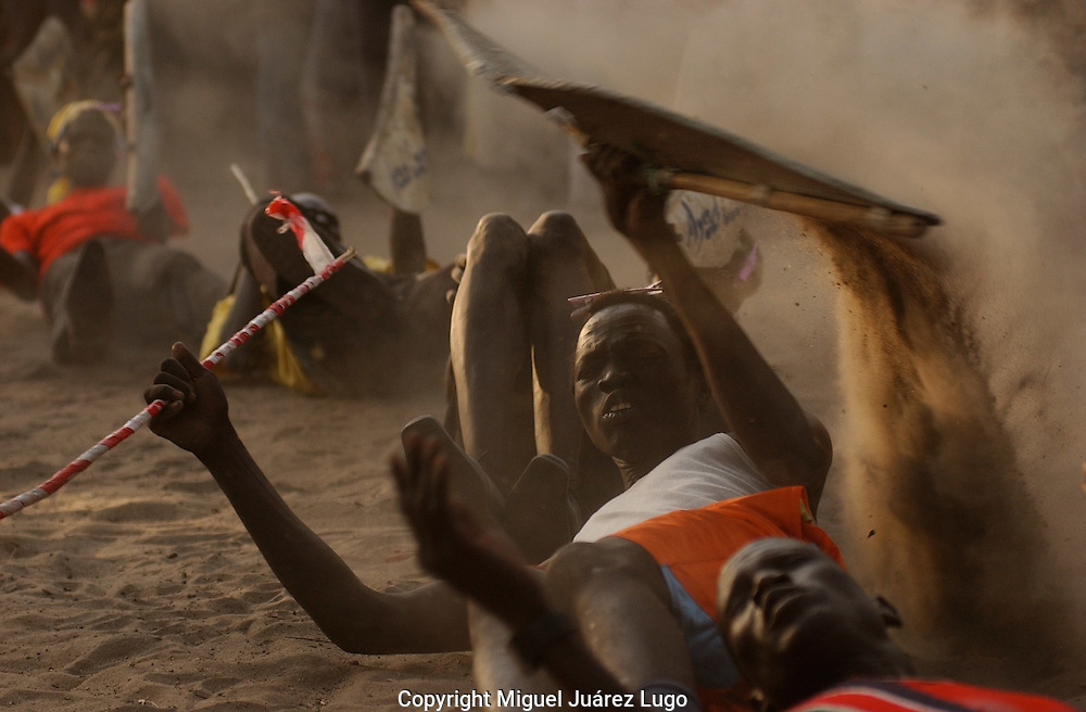 Nuer warriors show their skills, during celebrations in Ayod town, after the conclusion of the Referendum for Independence in South Sudan.  (PHOTO: MIGUEL JUAREZ LUGO).