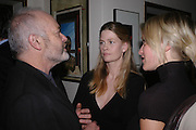 Mike Radford and  Lady Alexandra Gordon-Lennox    .Dinner at San Lorenzo, Beauchamp Place after Tod's hosts Book signing with Dante Ferretti celebrating the launch of 'Ferretti,- The art of production design' by Dante Ferretti. 19 April 2005.  ONE TIME USE ONLY - DO NOT ARCHIVE  © Copyright Photograph by Dafydd Jones 66 Stockwell Park Rd. London SW9 0DA Tel 020 7733 0108 www.dafjones.com