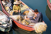 01 DECEMBER 1988  - HONG KONG: Fisherfolk mend their nets on Hong Kong.  PHOTO © JACK KURTZ  traditional  family  lifestyle  poverty  fishing  water  food