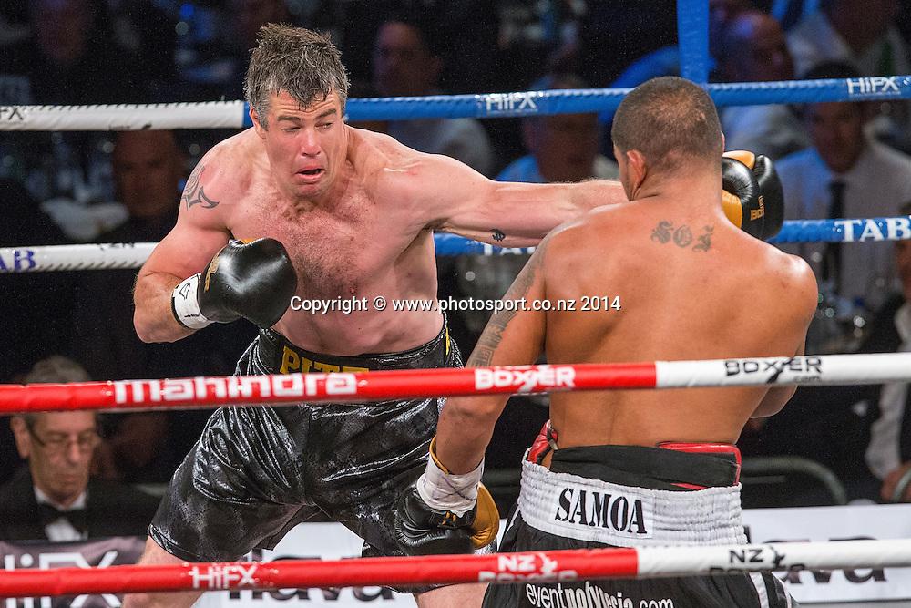 Brad `Hollywood` Pitt (L) fights Vaitele SoI in the Mahindra Super 8 Fight Night, North Shore Events Centre, Auckland, New Zealand, Saturday, November 22, 2014. Photo: David Rowland/Photosport