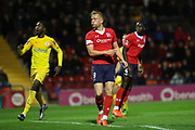 York City forward Jordan Burrow (9) looks relieved after slicing a clearance during the Vanarama National League match between York City and Chester FC at Bootham Crescent, York, England on 13 November 2018.