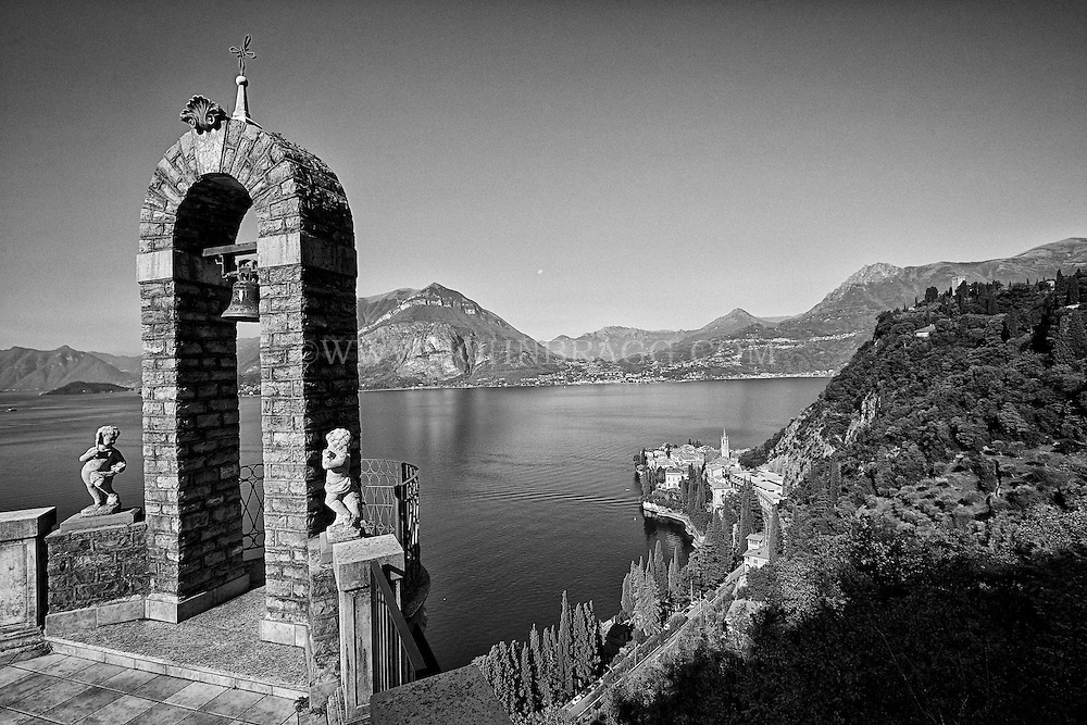 Black and white view of an archway high above Lake Como in Lombardy, Italy.