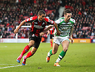 Picture by Tom Smith/Focus Images Ltd 07545141164<br /> 26/12/2013<br /> Lewis Grabban (left) of Bournemouth and Shane Duffy (right) of Yeovil Town battle for the ball during the Sky Bet Championship match at the Goldsands Stadium, Bournemouth.
