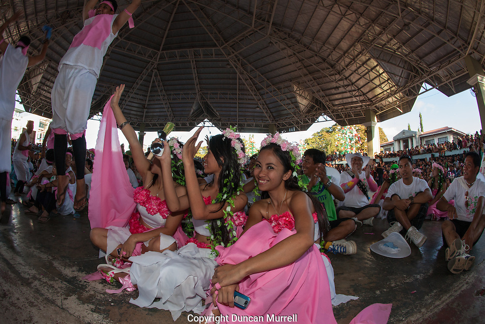 Presentation of prizes for the Balayong Festival street dancing competition.The festival at the beginning of March commemorates the founding anniversary of the City of Puerto Princesa, Palawan, highlighted by balayong tree-planting, street dancing and a colourful floral parade depicting the Palawan cherry blossoms from which the festival derives its name. The Palawan cherry is one of the most popular flowering trees in Palawan and known by the locals as the Balayong, a beautiful tree that when it is in full bloom resembles the cherry blossoms of Japan.