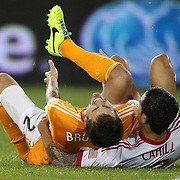 Eric Brunner, (left), Houston Dynamo, and Tim Cahill, New York Red Bulls after colliding during the New York Red Bulls V Houston Dynamo , Major League Soccer second leg of the Eastern Conference Semifinals match at Red Bull Arena, Harrison, New Jersey. USA. 6th November 2013. Photo Tim Clayton