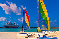 Hobie Cats (cataramarans) with Disney Dream cruise ship docked at Castaway Cay (Disney's private island) in background, The Bahamas