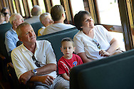LANSDALE, PA - AUGUST 24: Passengers Tom Borneman, Jackson Headly, 4, and Kathy Boreman of Lansdale, Pennsylvania enjoy the ride aboard the New Hope and Ivyland Railroad during Founders Day August 24, 2013 in Lansdale, Pennsylvania. The New Hope and Ivyland Railroad made special trips as part of Founders Day from Lansdale to Souderton. (Photo by William Thomas Cain/Cain Images)