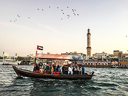 Images of a creek crossing in a typical Abra boat, Dubai. Images from the MSC Musica cruise to the Persian Gulf, visiting Abu Dhabi, Khor al Fakkan, Khasab, Muscat, and Dubai, traveling from 13/12/2015 to 20/12/2015.