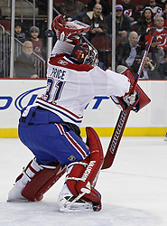 Dec 16, 2009; Newark, NJ, USA; New Jersey Devils right wing Ilkka Pikkarainen (17) scores his first NHL goal as the puck tips off the glove of Montreal Canadiens goalie Carey Price (31) during the second period at the Prudential Center.