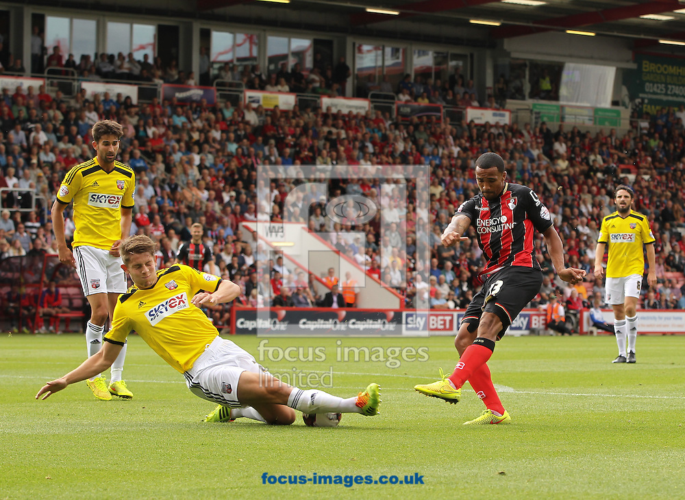 Callum Wilson (centre right) of Bournemouth takes a shot but it is blocked by James Tarkowski (centre left) of Brentford during the Sky Bet Championship match at the Goldsands Stadium, Bournemouth<br /> Picture by Tom Smith/Focus Images Ltd 07545141164<br /> 16/08/2014