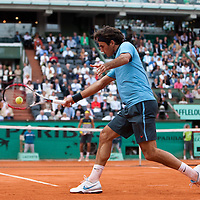 5 June 2009: Roger Federer of Switzerland hits a backhand during the Men's Singles Semi Final match on day thirteen of the French Open at Roland Garros in Paris, France.