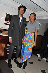 CHARLIE CASELY-HAYFORD and his sister ALICE CASELY-HAYFORD at a party hosted by TopShop to celebrate 10 years of NEWGEN and 10 years of supporting Brtish Fashion held at Le Baron, 29 Old Burlington Street, London W1 on 21st February 2012.