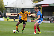 Newport forwarder Zak Ansah and Portsmouth defender Adam Webster during the Sky Bet League 2 match between Newport County and Portsmouth at Rodney Parade, Newport, Wales on 17 October 2015. Photo by Jemma Phillips.