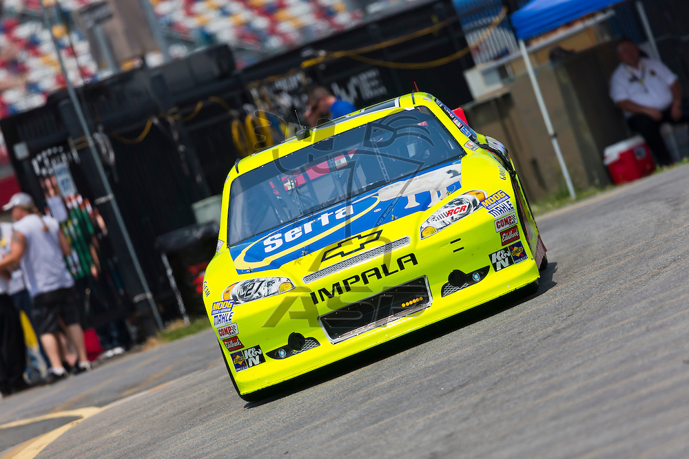 CONCORD, NC - MAY 26, 2012:  Paul Menard (27) brings his Serta Chevrolet on the track for a practice session for the Coca-Cola 600 at the Charlotte Motor Speedway in Concord, NC.
