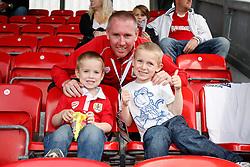 Brisol CIty Head  of Communications Adam Baker poses with his children at the game  - Photo mandatory by-line: Rogan Thomson/JMP - 07966 386802 - 20/09/2014 - SPORT - FOOTBALL - Highbury Stadium, Fleetwood - Fleetwood Town v Bristol City - Sky Bet League 1.