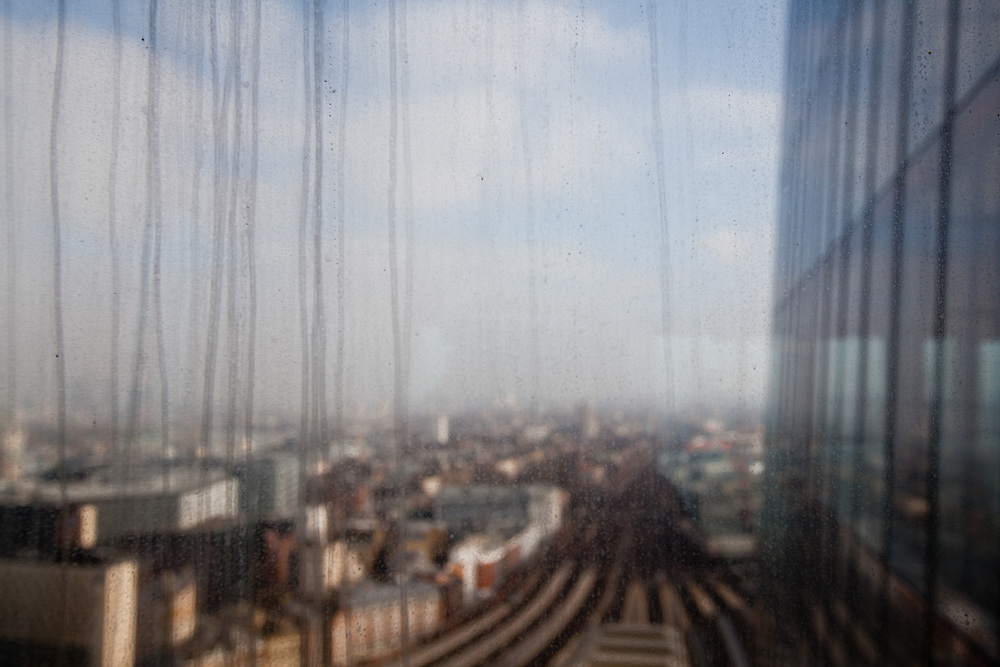 VIEW FROM THE SHARD BUILDING AT LONDON BRIDGE, THROUGH THE DIRTY WINDOWS DURING CONSTRUCTION. THE SHARD, DESIGNED BY ITALIAN ARCHTECT RENZO PIANO IS TO BE THE TALLEST BUILDING IN EUROPE AND WILL BE A MIX OF OFFICE RETAIL AND RESIDENTIAL.